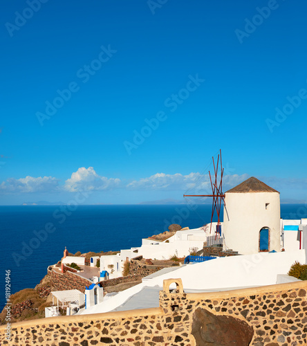 Foto op Canvas Santorini Traditional windmill in Oia, Santorini, Freece, panoramic image.