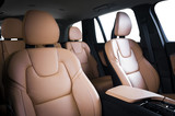 Luxury car inside. Interior of prestige modern car. Comfortable leather seats. Red perforarated leather cockpit with isolated white background. - 181925733