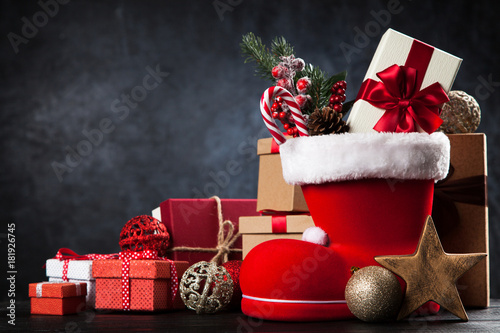 Santa's shoe on dark background - 181926745