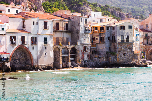 Fotobehang Palermo Beautiful old harbor with buildings and fortress on the hill in Cefalu, Sicily, Italy.