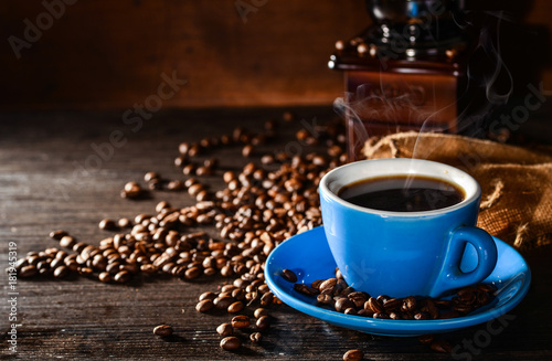 Fotobehang Koffiebonen Coffee cup and coffee beans on old wooden background