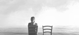 alone woman sitting next to her lover's empty chair - 181951973