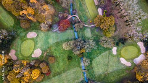 Fotobehang Olijf Drone view of a golf course with colorful trees