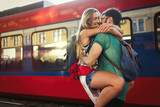 Beautiful couple parting at train station - 181976569