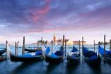 Row of gondolas parked on city pier - 181978593