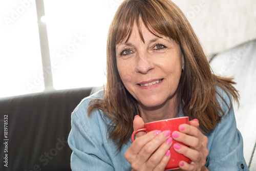 Sticker Mature woman during coffee break at home