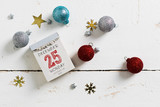 Tear off calendar with christmas day, monday of december the 25th, on top