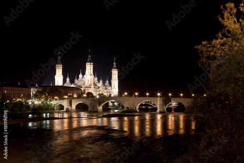 El Pilar cathedral in Zaragoza with the stone bridge, Spain