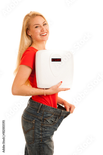 Woman wears too big trousers as she loose weight - weightloss