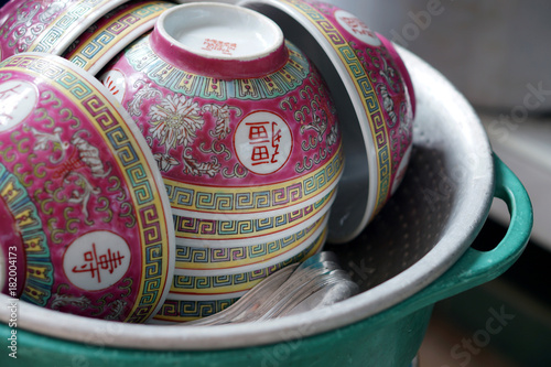 Closeup Stack of Chinese pattern bowls in basin