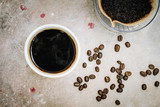 A coffee cup with roasted coffee beans and drip coffee kits. - 182010373