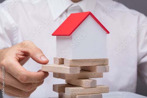 Fototapeta Businessman Balancing Property Sector