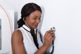 Woman Placing Stethoscope On Wall - 182027371