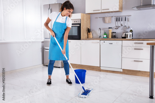 Woman Cleaning Floor With Mop - 182033554