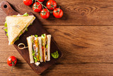 Delicious toast sandwich with ham, cheese, egg and vegetables. - 182045339