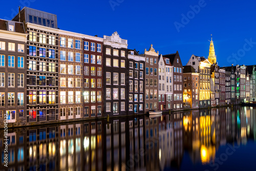 Foto op Canvas Amsterdam Canals and tradition house in Amsterdam at night. Amsterdam is the capital and most populous city of the Netherlands.