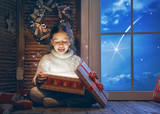 girl by window at Christmas - 182050140