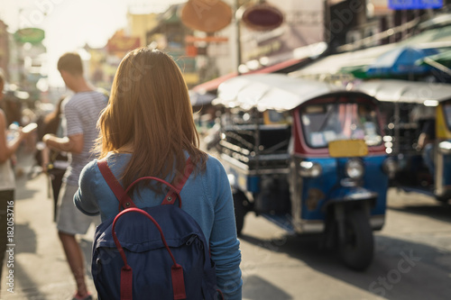 Poster Bangkok young woman traveler walking Khao San road