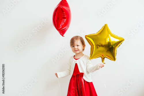 Little baby girl holding balloons in the form of stars Poster