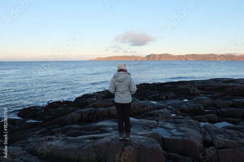 Keuken foto achterwand Grijze traf. Woman traveler standing with beautiful landscape of tundra meadow