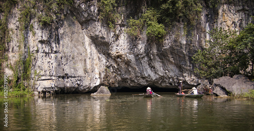The boat is next to the rock. Ninh Binh Province, Ha Long Bay on land, Vietnam