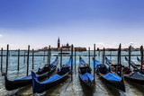 A view of the Cathedral of San Giorgio Maggiore, Venice lagoon and gondolas from the Piazza San Marco, Venice, Italy