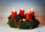 Advent wreath with four red burning candles and christmas decoration on rustic bright wood with copy space, - 182080548