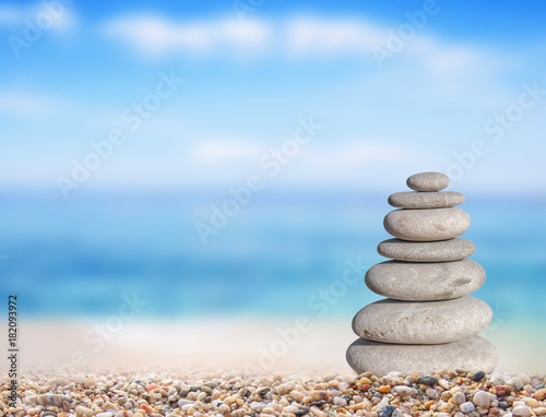 Foto op Aluminium Zen Small beach stone from large to small on beach like symbol of balance