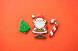 Festive Christmas concept background. Santa, fir tree, and candy canes gingerbread  cookies. Top view. - 182123786