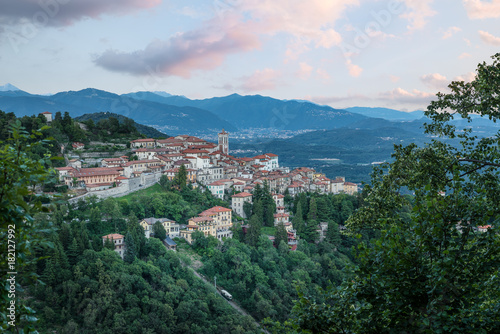 Sacro Monte of Varese (Santa Maria del Monte), Varese - Italy. Picturesque view of the small medieval village at sunset. Below the funicular is visible. World heritage site - UNESCO site