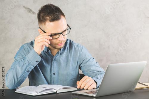 Attractive gentleman working on project