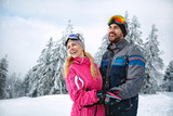 Male and female happy together in snowy mountain