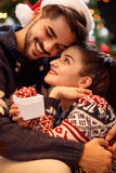 Loving Christmas couple enjoying in the holidays. - 182148761