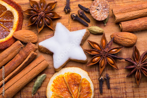 Fototapeta Christmas spices - Flat lay - Cinnamon, Anise, Cookie, Oranges and other
