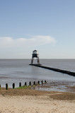 Dovercourt Lighthouse on jetty with Beach in Foreground - 182152327