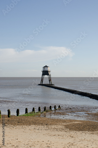 Dovercourt Lighthouse on jetty with Beach in Foreground Poster