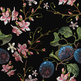 Embroidery plums branch and pink cherry blossom seamless pattern template fashionable clothes, t-shirt design. Classical embroidery blossoming plum and cherry flowers on black background - 182154178