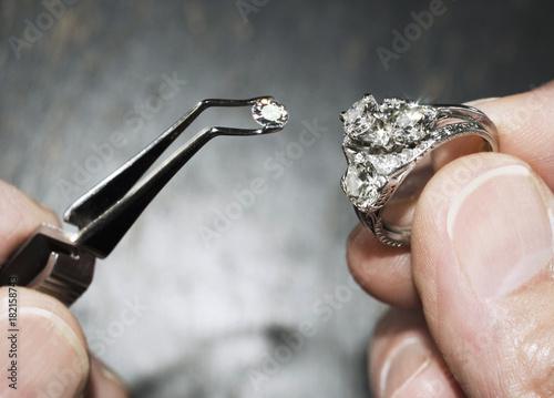 diamond in tweezers with ring © kentannenbaum46