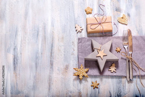 Christmas table setting with christmas star decoration and gingerbread cookie copy space, festive dinner - 182166136