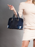 Part body of elegant woman with bag. - 182170348
