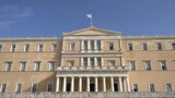 waving flag on the Greek parliament building in Athens, Greece - 182173389