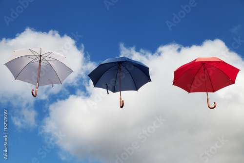 Floating Umbrellas in White, Dark Blue and Red Poster