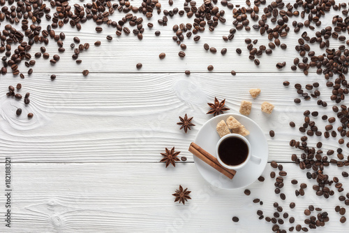 Wall mural cup of coffee on white table