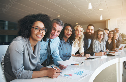 Smiling group of diverse colleagues working together in an office