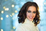 portrait of beautiful smiling girl on holiday with makeup and hairdo