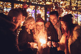 Friends With Sparklers At The New Year Party - 182209123
