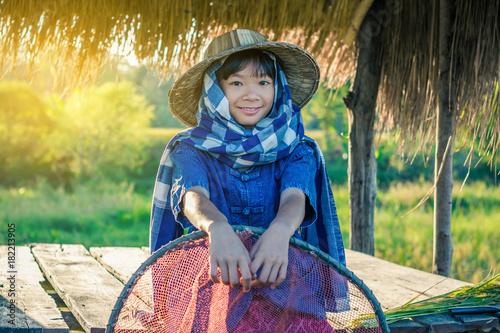 Papiers peints Jaune de seuffre Woman farmer is harvesting rice in Thailand, Concept farmer.