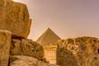 Pyramid in Giza framed between limestone blocks