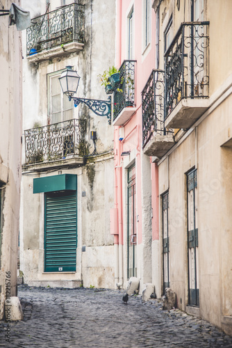 Buildings on narrow cobbled street in Lisbon with artistic metalwork - 182215766