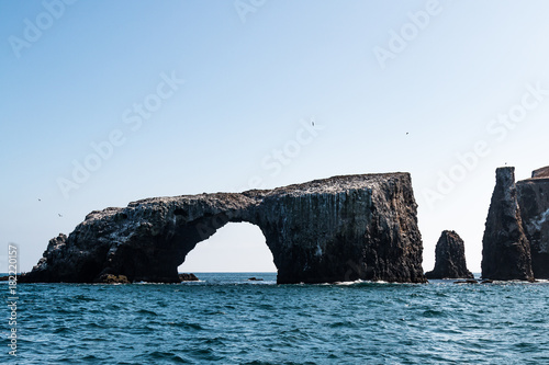 Arch Rock natural bridge and other nearby volcanic rock formations at East Anacapa Island in Channel Islands National Park off the coast from Ventura, California.